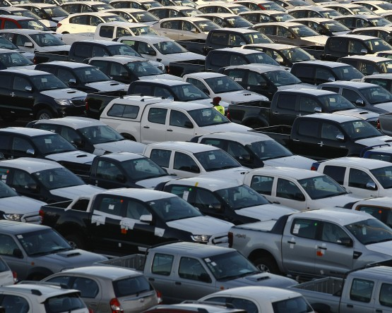 June vehicle sales figures expected, and petrol price hikes in July. Picture: Bloomberg