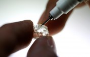 De Beers sells twice as many diamonds as it mines to clear stock