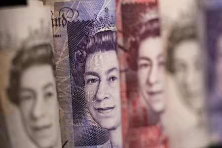Sterling hits one-month low, FTSE gains