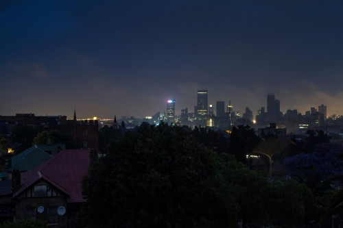 Darkness surrounds residential homes due to load shedding in Troyeville, Johannesburg. Image: Dean Hutton, Bloomberg
