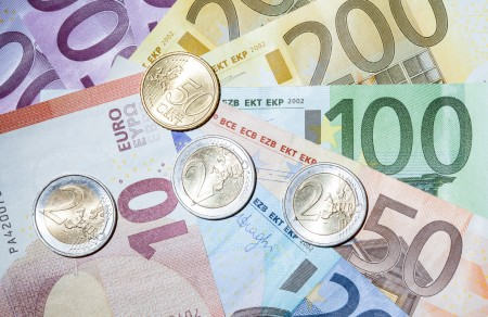 Euro zone economy sparkles, lights way for ECB pull-back
