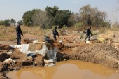 Sibanye says 202 illegal miners arrested at Cooke mine