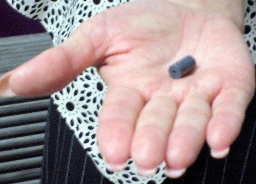 Elena Shedko, public relations officer of the Rostov Nuclear Power Plant's information centre in Volgadonsk, Russia, shows what a nuclear fuel pellet looks like.