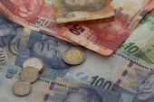 Rand firms by 1% on emerging markets rally