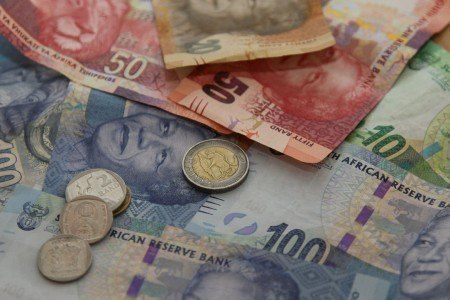 Rand, stocks fall on strong dollar, drop in commodity prices