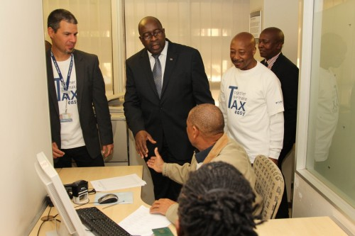 Finance Minister Nhlanhla Nene (middle) greets staff at the Pretoria CBD branch at the start of Filing Season. Commissioner Tom Moyane is on the right with branch manager Justin Hawker on the left.