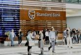 Standard Bank misses estimates as impairment charges jump