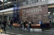 Standard Bank surges as interims beat expectations