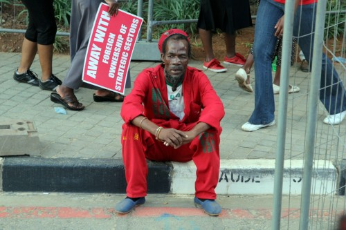 An EFF member takes a rest after walking most of the day during the march.