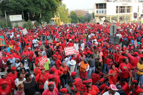 Members of the EFF march to the JSE in Sandton.
