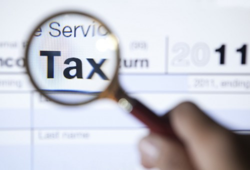 tax return, magnifying glass, tax services