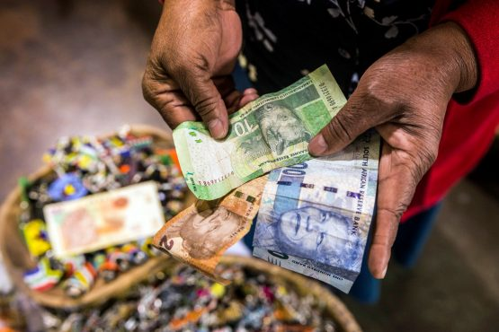 The rand could weaken as much as 4% to 12.50 per dollar as political instability increases, analyst says. Picture: Bloomberg
