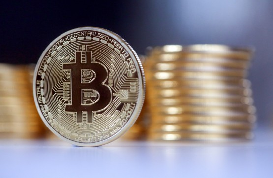 Billionaires, funds and celebrities are buying bitcoin, which has shown its capacity to protect against inflation. Image: Chris Ratcliffe, Bloomberg