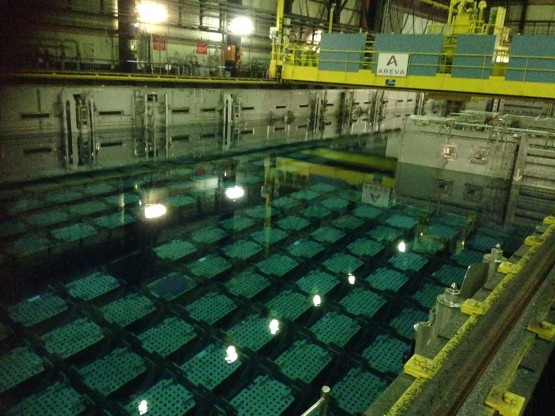 The pool at Areva's La Hague plant where spent nuclear fuel is stored for about five years before recycling. 96% of the fuel can be recycled, reducing the volume of the remaining waste by 80%. Every square 'basket' contains nine fuel assemblies. The pool is 9 metres (m) deep with the baskets sitting at a depth of 5m, maintaining a 4m-barrier for radiation protection.