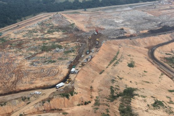 Seen from the air, trucks lining up to dispose of waste in cell 2 of the FG Landfill site.