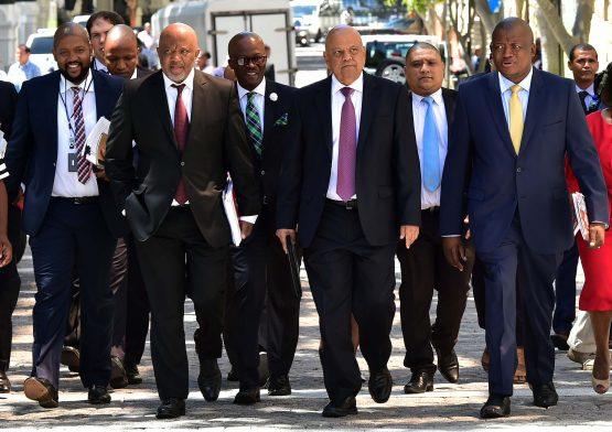 Minister Pravin Gordhan, Deputy Minister Mcebisi Jonas and Director General Lungile Fuzile arrive ahead of the 2017 Budget Speech