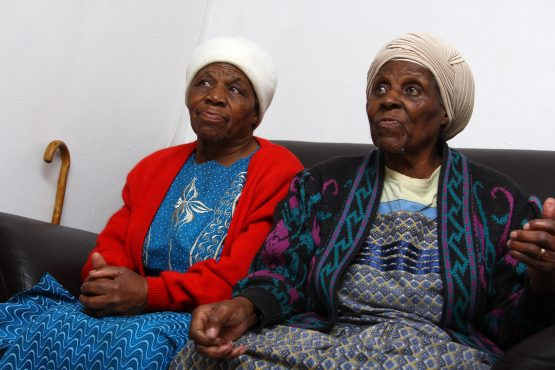 Triyphina Kunene, 81, and Hilda Sibanda ,92, say apart from spending their grant money on food, the biggest cost is funeral policies.