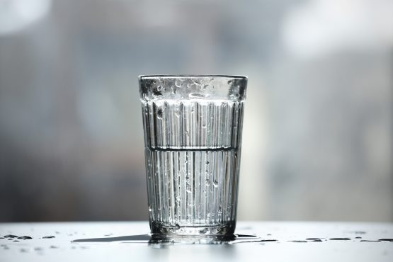 Local equity returns have been weak, but we have the benefit of high interest rates, leaving SA investors unsure whether the glass is half full or half empty. Image: Shutterstock