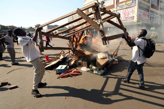 Demonstrators set fire to wooden pallets and rubbish in Harare, Zimbabwe. Picture: Reuters