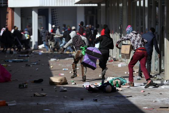 Demonstrators loot stores as protests continued on July 12. Image: Siphiwe Sibeko, Reuters