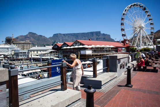 Tourists visit the restaurants and amusement areas of the V&A Waterfront district of Cape Town. Picture: Kevin Sutherland/Bloomberg