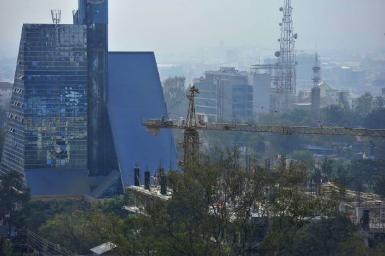 A construction crane operates above a new building on the city skyline in Nairobi, Kenya. Picture: Riccardo Gangale/Bloomberg