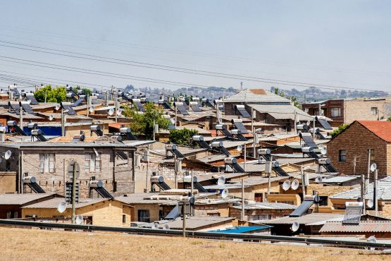 A pylon tower carries electrical power lines over residential shacks and electrical boxes in the Alexandra township. Picture: Waldo Swiegers/Bloomberg