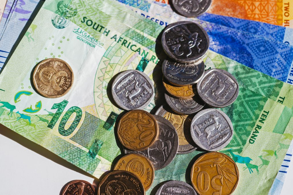 Rand firms as dollar slips, stocks flat