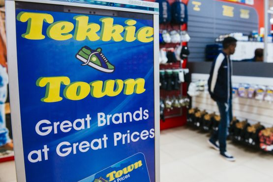 A customer browses goods on display inside a Tekkie Town shoe store, operated by Steinhoff International. Picture: Waldo Swiegers/Bloomberg