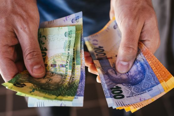 Rand firms against hobbling dollar, increased manufacturing production data and ahead of Moody's rating. Picture: Waldo Swiegers, Bloomberg