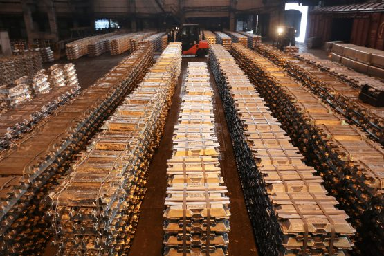 Bound aluminium ingots sit in a warehouse beside waiting freight wagons at the foundry in the Krasnoyarsk aluminium smelter, operated by United Co Rusal, in Krasnoyarsk, Russia. Picture: Andrey Rudakov/Bloomberg