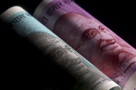 India to lower effective corporate tax rates and scrapped the minimum alternative tax for domestic companies in a bid to revive private investment. Image: Brent Lewin, Bloomberg