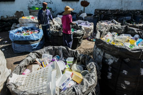 Waste pickers sort recyclables at an abandoned school in the Joburg CBD. Image: Waldo Swiegers, Bloomberg