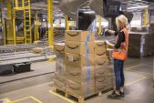 Amazon's push for one-day delivery dents profits