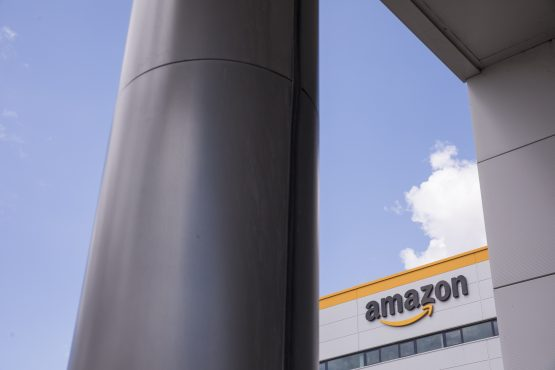 A sign sits outside the Amazon.com fulfilment centre in Tilbury, UK. Picture: Jason Alden/Bloomberg