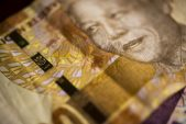 Rand firms ahead of president's lockdown address