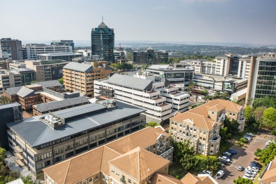 Commercial buildings stand on the skyline in Sandton. Image: Waldo Swiegers, Bloomberg