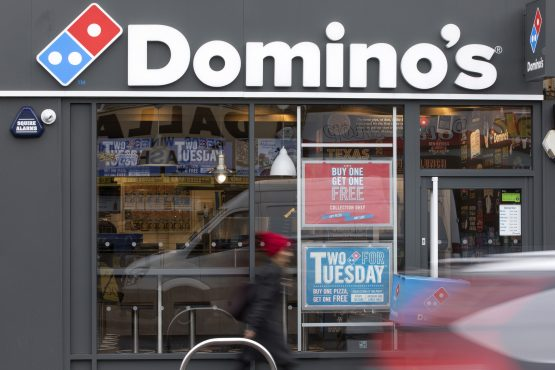 Taste Holdings is liquidating its food business in SA, which includes some 55 Domino's Pizza stores. Photographer: Jason Alden/Bloomberg