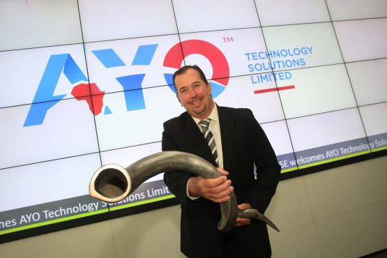 From one extreme to the other – Ayo's then CEO Kevin Hardy used a vuvuzela to amplify the noise around the company when it listed on the JSE in December 2017. Picture: Moneyweb