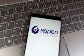 Aspen pays dividend after slashing debt levels