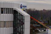 Aspen lowers debt, shares jump