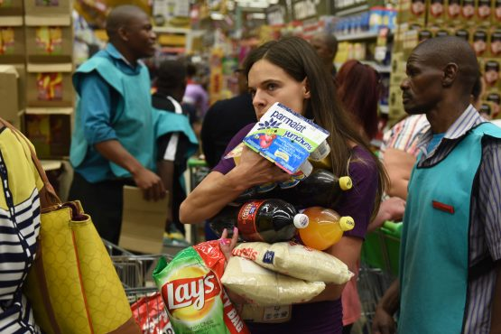 Consumers rushed to the shops on hearing of the 21-day lockdown, despite being told that stores will remain open. Image: The Citizen