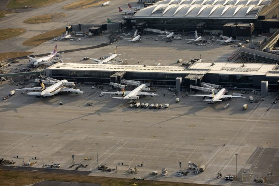 SAA and other aircraft at a passenger terminal building at London Heathrow Airport. Image: Matthew Lloyd, Bloomberg
