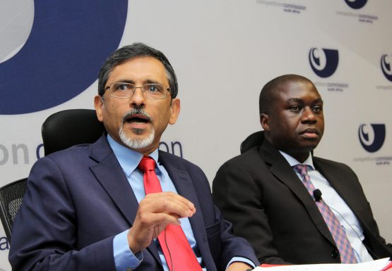 Ebrahim Patel, minister of Economic Development, and Hardin Ratshisusu, deputy commissioner of the CCSA, at the data services market inquiry in Johannesburg. Picture: Moneyweb