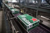Heineken SA to cut jobs, put investments on hold