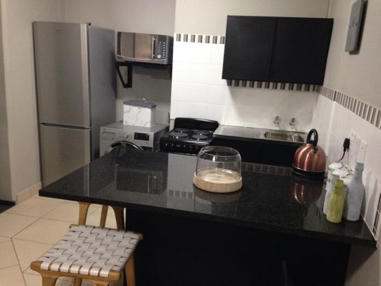 Typical bachelor unit kitchen.