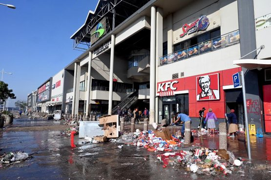 Community members start cleaning up after the devastation at Bridge City Mall in Durban on Thursday. Image: Elmond Jiyane, GCIS