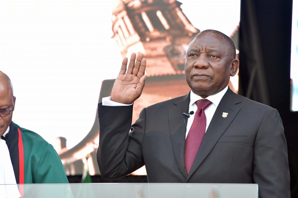 Promising jobs and justice, Ramaphosa sworn in as president