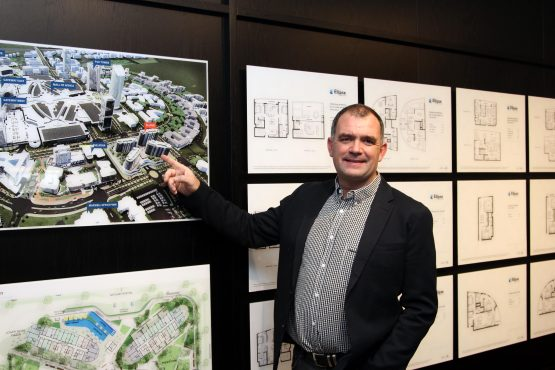Melt Hamman, CEO of JSE-listed Reit Attacq points to the planned R1.25bn Ellipse high-rise apartment development on a masterplan of its Waterfall City mega development, located midway between Johannesburg and Pretoria. Image: Moneyweb