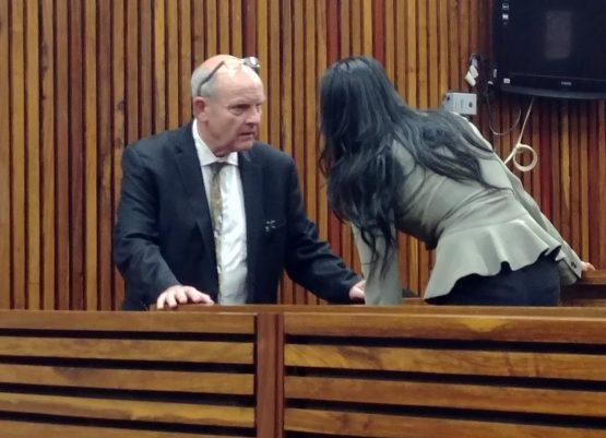 Forensic investigator Paul O'Sullivan speaking to his co-accused Melissa Naidu in the Randburg Magistrate's Court. Picture: Moneyweb